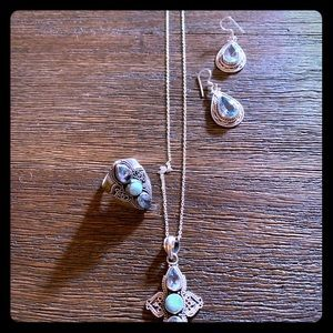 Artisan silver with blue topaz set